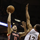 Toronto Raptors' Greivis Vasquez (21) shoots against Milwaukee Bucks' Ramon Sessions (13) during the first half of an NBA basketball game Saturday, April 5, 2014, in Milwaukee The Associated Press