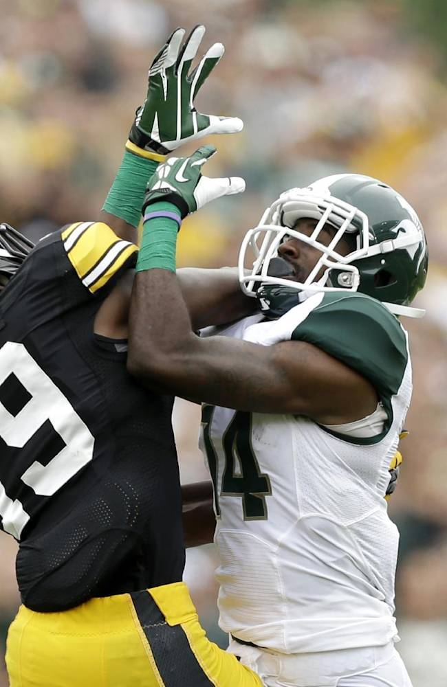 Iowa defensive back B.J. Lowery, left, breaks up a pass intended for Michigan State wide receiver Tony Lippett during the first half of an NCAA college football game, Saturday, Oct. 5, 2013, in Iowa City, Iowa