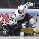 Los Angeles Kings defenseman Drew Doughty, left, and San Jose Sharks center Logan Couture battle during the third period of an NHL hockey game, Wednesday, Oct. 8, 2014, in Los Angeles. The Sharks won 4-0 The Associated Press