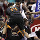 Phoenix Suns forward P.J. Tucker, left, gets in an altercation with Los Angeles Clippers forward Blake Griffin, right, as Suns guard Gerald Green (14) and Clippers center DeAndre Jordan get into the scrum during the second half of an NBA basketball game M
