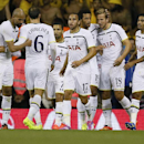Tottenham's Harry Kane, second right, celebrates with team mates after scoring a goal during the second leg Europa League qualifying soccer match between Tottenham Hotspur and AEL Limassol at White Hart Lane stadium in London Thursday, Aug. 28, 2014