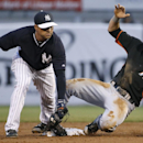New York Yankees second baseman Brian Roberts, left, forces out Miami Marlins' Christian Yelich in the third inning of a spring exhibition baseball game in Tampa, Fla., Friday, March 28, 2014. The Yankees defeated the Marlins 3-0 The Associated Press