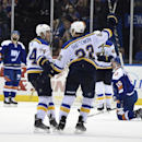 St. Louis Blues defenseman Kevin Shattenkirk (22) celebrates his goal with right wing T.J. Oshie (74) as New York Islanders defenseman Nick Leddy (2) and right wing Cal Clutterbuck (15) react in the second period of an NHL hockey game Saturday, Dec. 6, 20