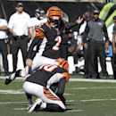 Cincinnati Bengals (2) kicker Mike Nugent boots a field goal from the hold of Kevin Huber during the second half of an NFL football game against the Baltimore Ravens in Cincinnati, Sunday, Oct. 26, 2014 The Associated Press