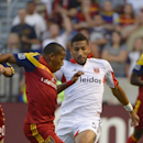 D.C. United defender Sean Franklin (5) tries to stop Real Salt Lake forward Joao Plata during the first half of an MLS soccer game Saturday, Aug. 9, 2014, in Sandy, Utah The Associated Press