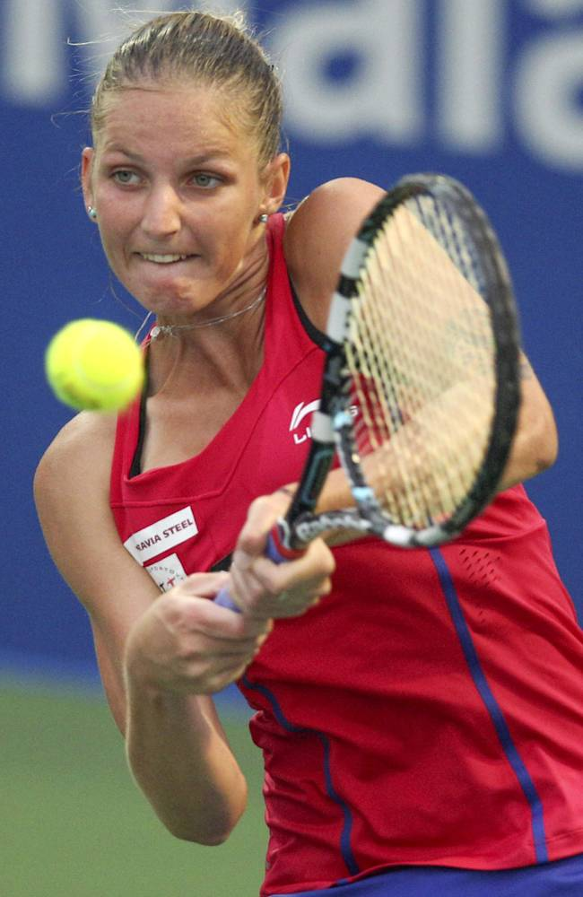 Karolina Pliskova of the Czech Republic returns a shot against Duan Yingying of China during their second round match at the WTA Malaysian Open tennis tournament in Kuala Lumpur, Malaysia, Thursday, April 17, 2014. (AP Photo)