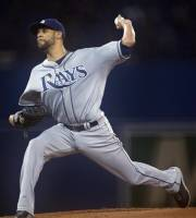 Tampa Bay Rays starting pitcher David Price throws to the Toronto Blue Jays during the first inning of a baseball game in Toronto on Friday, July 19, 2013. (AP Photo/The Canadian Press, Frank Gunn)