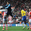 Stoke's goalkeeper Asmir Begovic saves during the English Premier League soccer match between Stoke City and Arsenal at Britannia Stadium in Stoke On Trent, England, Saturday, March 1, 2014