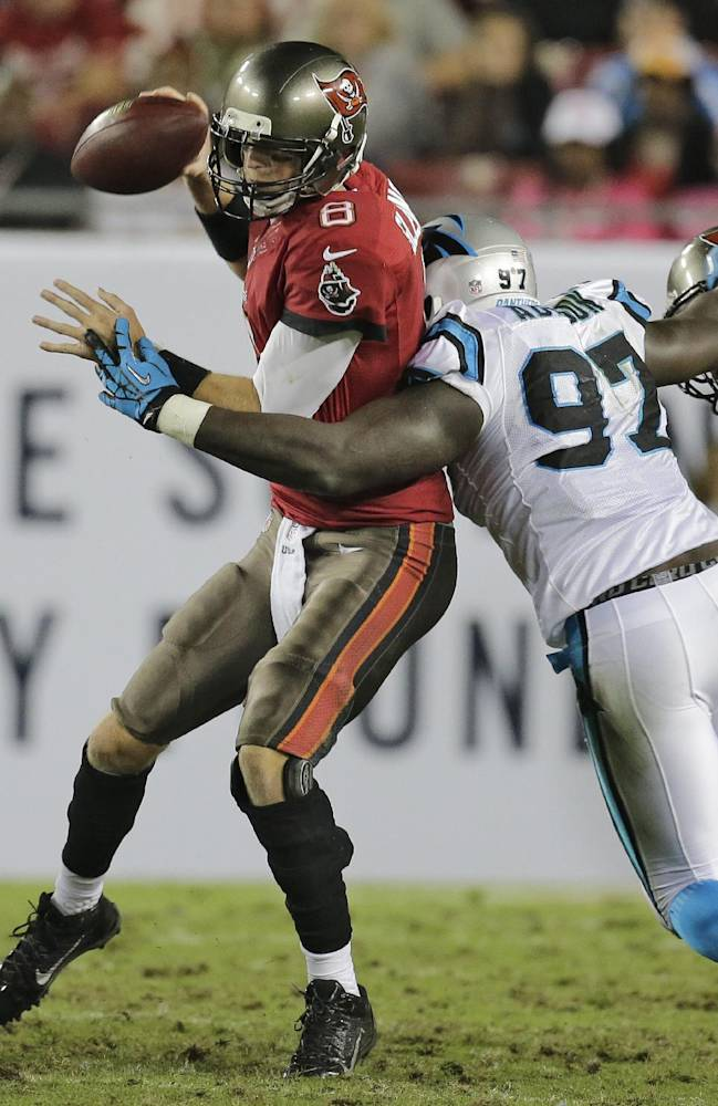 Tampa Bay Buccaneers quarterback Mike Glennon (8) is sacked by Carolina Panthers defensive end Mario Addison (97) during the fourth quarter of an NFL football game Thursday, Oct. 24, 2013, in Tampa, Fla