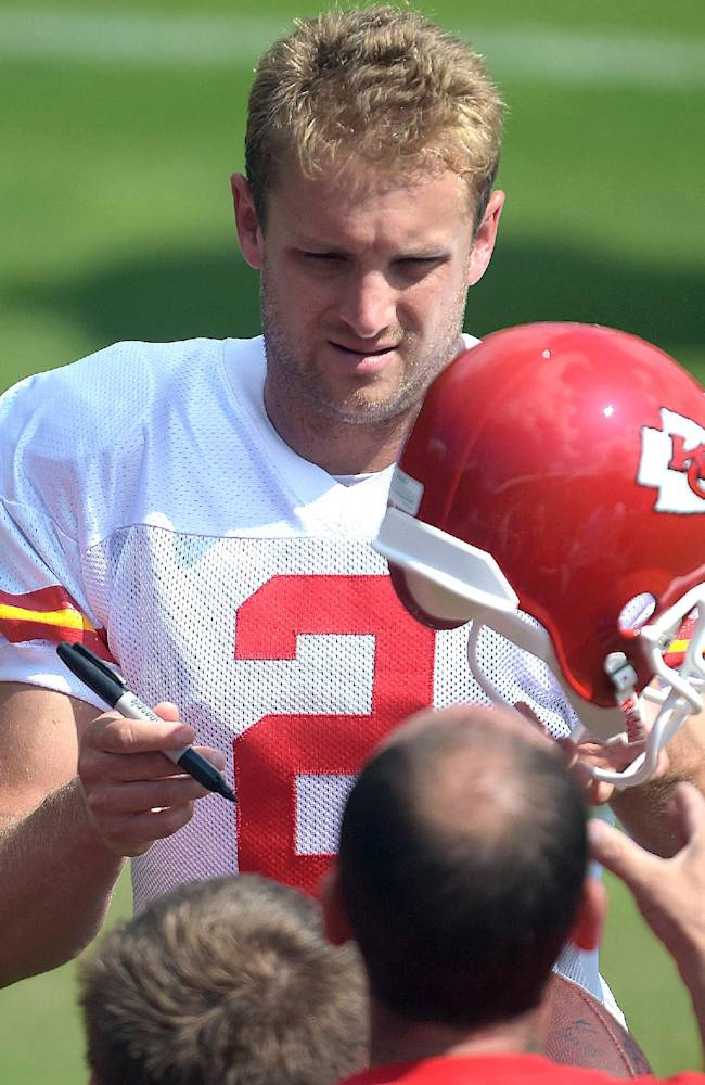 Kansas City Chiefs Dustin Colquitt (2) signs autographs after practice Monday morning, Aug. 11, 2014, on the Missouri Western State University campus in St. Joseph. Mo