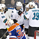San Jose Sharks Brent Burns (88), Patrick Marleau (12), Joe Pavelski (8) and Joe Thornton (19) celebrate a goal in front of Edmonton Oilers goalie Ben Scrivens (30) during third period NHL hockey action in Edmonton, Alta., on Tuesday March 25, 2014 The As