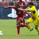 Toronto FC's Jeremy Hall, left, battles for the ball against Columbus Crew's Matias Sanchez, right, during the first half of an MLS soccer match in Toronto on Saturday, July 27, 2013. (AP Photo/The Canadian Press, Michelle Siu)