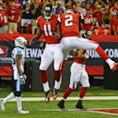 Atlanta Falcons quarterback Matt Ryan (2) and wide receiver Julio Jones celebrate a touchdown pass against the Tennessee Titans during the second quarter of an NFL preseason football game Saturday, Aug. 23, 2014, in Atlanta The Associated Press