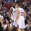 DeAndre Jordan #6 and Blake Griffin #32 of the Los Angeles Clippers celebrate against the Golden State Warriors in Game Five of the Western Conference Quarterfinals during the 2014 NBA Playoffs at Staples Center on April 29, 2014 in Los Angeles, California. (Photo by Stephen Dunn/Getty Images)