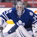 Toronto Maple Leafs goaltender James Reimer keeps a close eye on the puck during third period of an NHL hockey game in Toronto, Monday, Jan. 19, 2015 The Associated Press