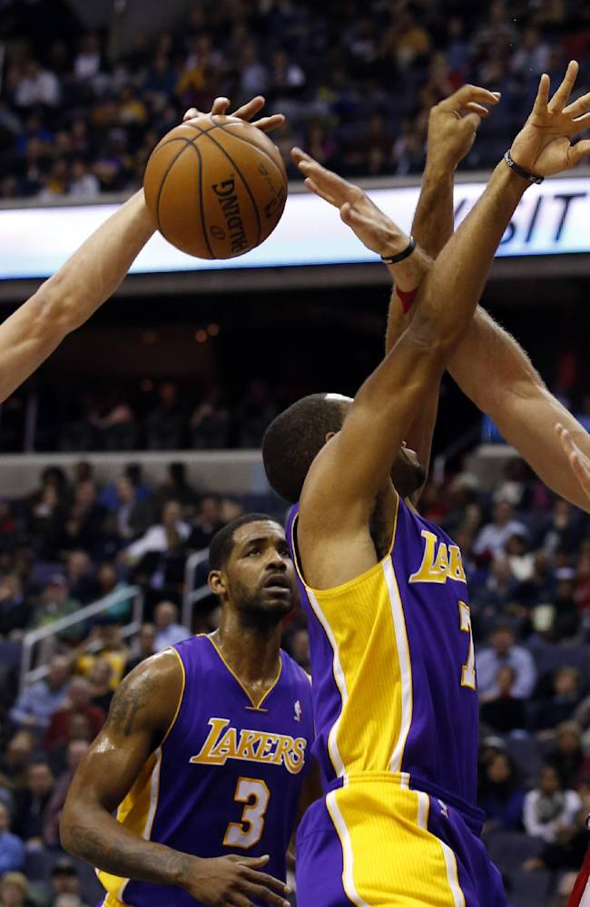 Washington Wizards forward Jan Vesely (24), from the Czech Republic, and center Marcin Gortat (4), from Poland, combine to block a shot by Los Angeles Lakers forward Xavier Henry (7) in the first half of an NBA basketball game Tuesday, Nov. 26, 2013, in Washington