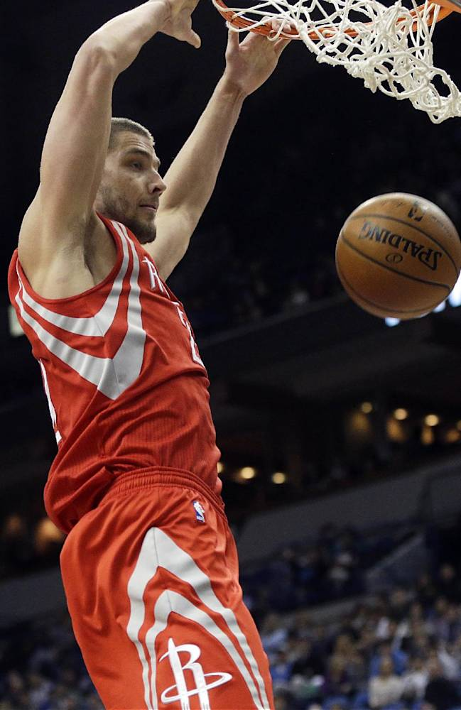 Houston Rockets' Chandler Parsons dunks in the second half of an NBA basketball game against the Minnesota Timberwolves, Monday, Feb. 10, 2014, in Minneapolis. Parsons led the Rockets with 20 points in their 107-89 win