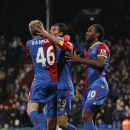 Crystal Palace's Marouane Chamakh, center, celebrates his goal against West Ham United with teammates Cameron Jerome, right, and Barry Bannan during their English Premier League soccer match at Selhurst Park, London, Tuesday, Dec. 3, 2013
