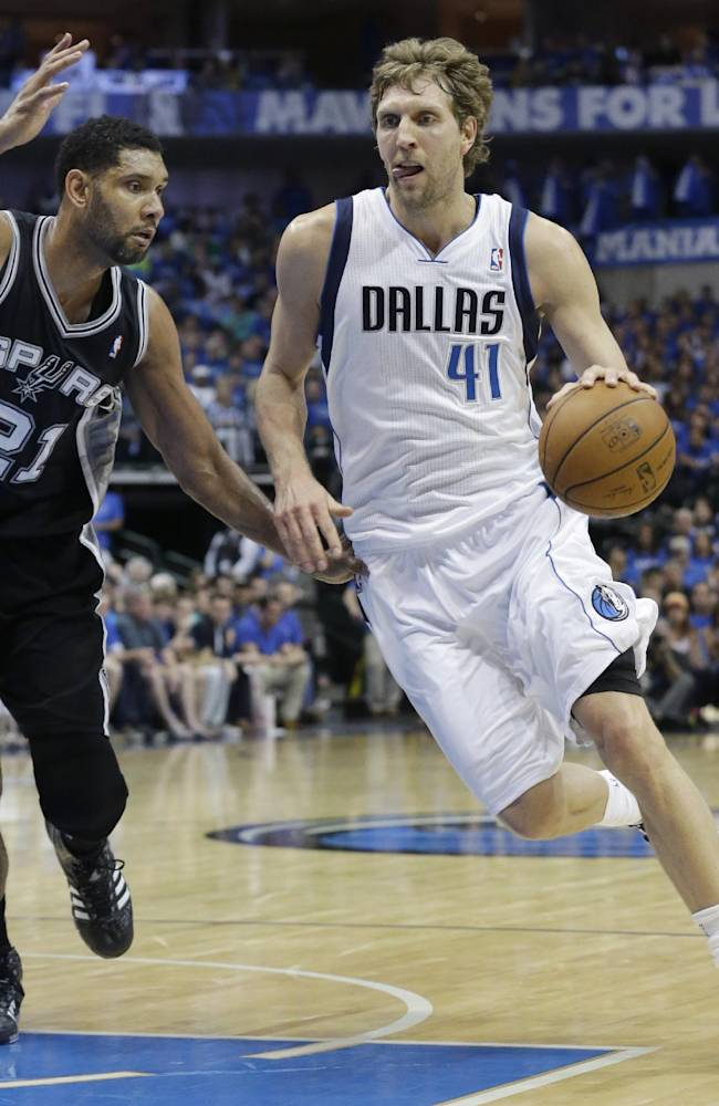 Dallas Mavericks forward Dirk Nowitzki (41), of Germany, drives against San Antonio Spurs forward Tim Duncan (21) during the first half of Game 3 of an NBA basketball first-round playoff series in Dallas, Saturday, April 26, 2014
