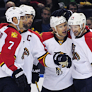 From left to right, Florida Panthers' Dmitry Kulikov, Wille Mitchell, Sean Bergenheim and Brad Boyes celebrate the only goal of the game, by Bergenheim, during the second period of an NHL hockey game against the Buffalo Sabres, Friday, Oct., 17, 2014, in