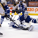 Toronto Maple Leafs goaltender Jonathan Bernier, right, makes a save on Boston Bruins center David Krejci during the first period of an NHL hockey game in Toronto on Thursday, April 3, 2014 The Associated Press