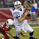 Indianapolis Colts' Andrew Luck (12) runs away from the blitz of Arizona Cardinals' Tyrann Mathieu (32) during the second half of an NFL football game Sunday, Nov. 24, 2013, in Glendale, Ariz. The Cardinals defeated the Colts 40-11 The Associated Press