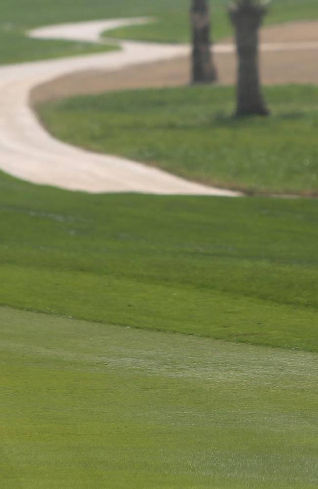 Rory McIlroy of Northern Ireland plays a ball on the 1st hole during the 1st round of the Abu Dhabi HSBC Golf Championship in Abu Dhabi, United Arab Emirates, Thursday, Jan. 16, 2014