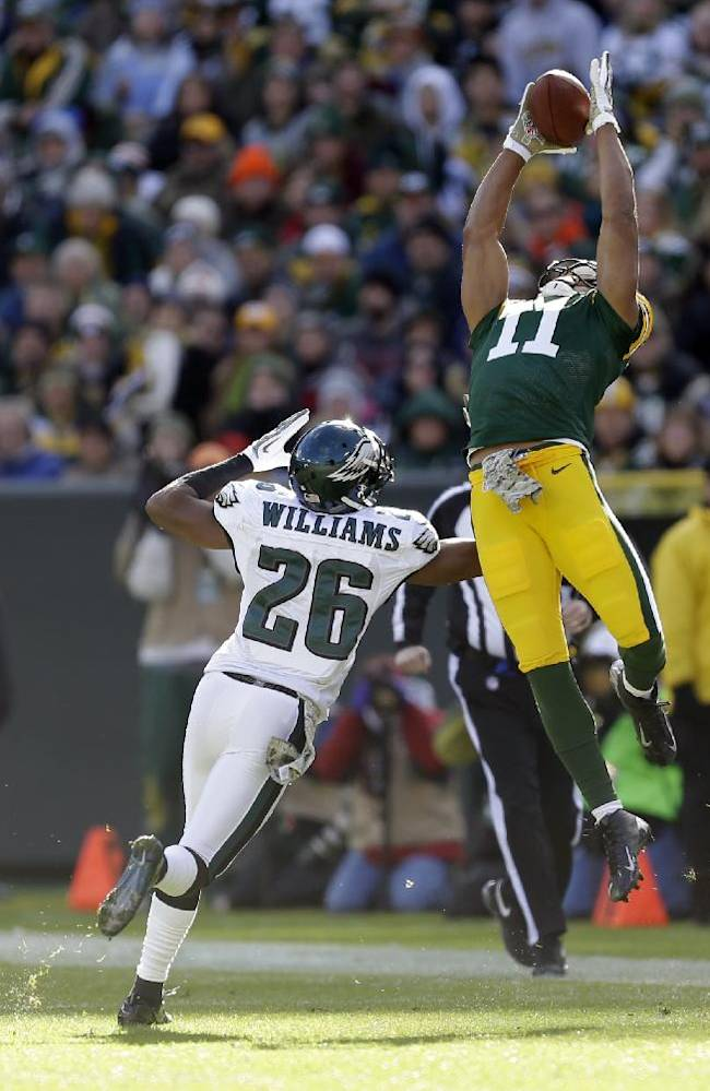 Green Bay Packers' Jarrett Boykin goes up for a pass over Philadelphia Eagles' Cary Williams (26) during the first half of an NFL football game Sunday, Nov. 10, 2013, in Green Bay, Wis
