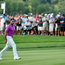 Jun 19, 2016; Oakmont, PA, USA; Jason Day waves to the crowd as he walks to the 18th green during the final round of the U.S. Open golf tournament at Oakmont Country Club. Mandatory Credit: John David Mercer-USA TODAY Sports