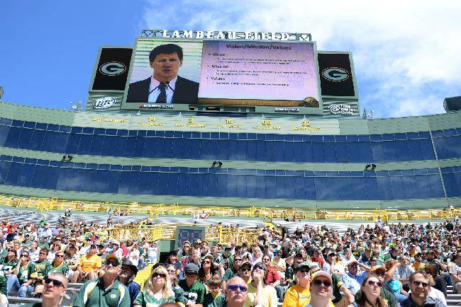 In this July 24, 2013 file photo, Green Bay Packers fans and stockholders attend the Packers NFL football team annual shareholders meeting at Lambeau Field in Green Bay, Wis. The screen at top shows team president Mark Murphy. The Packers offer their annual glimpse into the financial health of the only publicly owned team in the NFL, Thursday, July 10, 2014