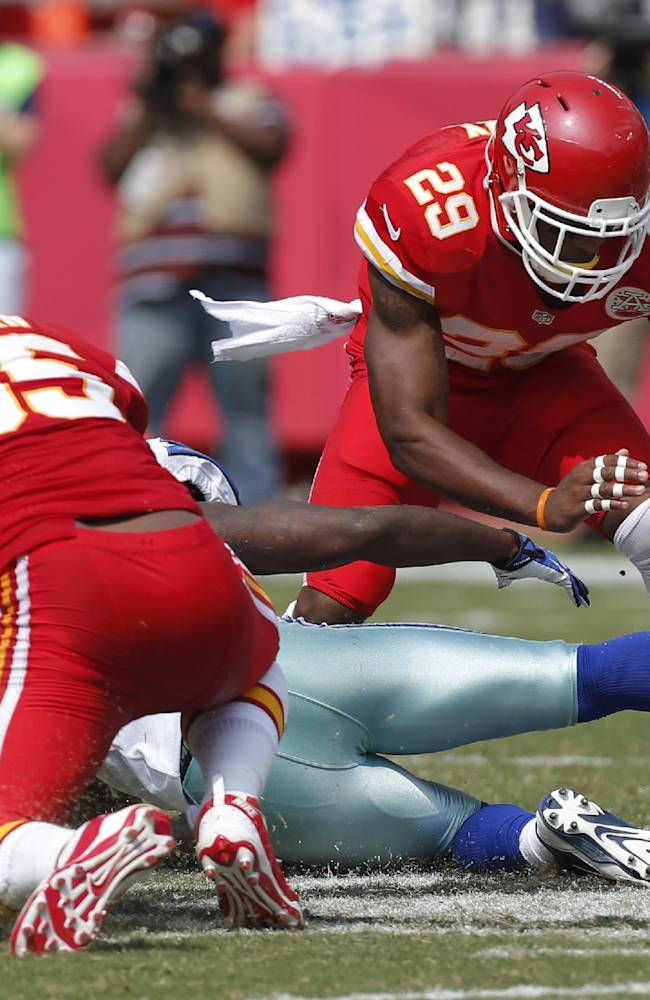 In this Sept. 15, 2013, file photo, Kansas City Chiefs strong safety Eric Berry (29) picks up a fumble by Dallas Cowboys' Lance Dunbar, as Chiefs inside linebacker Akeem Jordan (55) looks for the ball on the play, during the second half of an NFL football game against the Dallas Cowboys at Arrowhead Stadium in Kansas City, Mo. The Chiefs haven't lost a fumble. And an opportunistic defense has forced nine turnovers through three games, altogether providing the biggest reason that they're off to a perfect start this season