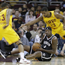 Cleveland Cavaliers' Alonzo Gee (33) and Tristan Thompson (13) loom over Brooklyn Nets' Andray Blatche (0) during the first quarter of an NBA basketball game Wednesday, April 16, 2014, in Cleveland The Associated Press