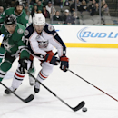 Dallas Stars' Jason Demers (4) knocks the puck away from Columbus Blue Jackets' Sean Collins (37) in the second period of an NHL hockey game, Tuesday, Jan. 6, 2015, in Dallas The Associated Press