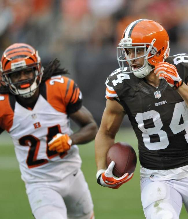 Cleveland Browns tight end Jordan Cameron (84) runs away from Cincinnati Bengals cornerback Adam Jones (24) after a catch in the fourth quarter of an NFL football game on Sunday, Sept. 29, 2013, in Cleveland. The Browns won 17-6