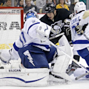 Pittsburgh Penguins' Steve Downie (23) knocks a rebound past Tampa Bay Lightning goalie Evgeni Nabokov (20) for a goal during the second period of an NHL hockey game in Pittsburgh Monday, Dec. 15, 2014 The Associated Press