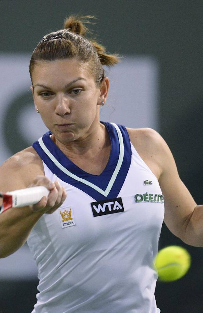 Simona Halep, of Romania, hits to Agnieszka Radwanska, of Poland, during their semifinal match at the BNP Paribas Open tennis tournament, Friday, March 14, 2014, in Indian Wells, Calif