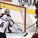 Phoenix Coyotes' Martin Hanzal (11), of the Czech Republic, scores a goal against Colorado Avalanche's Semyon Varlamov (1), of Russia, as Avalanche's Erik Johnson (6) and Coyotes' Tim Kennedy (34) look on during the third period of an NHL hockey game Thur