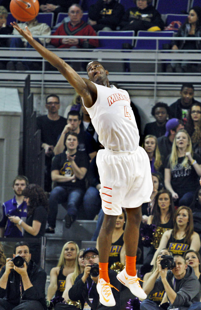 UTEP's Julian Washburn (4) reaches for the rebound against East Carolina during an NCAA college basketball game on Thursday, Feb. 6, 2014, in Greenville, N.C