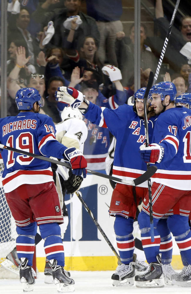 Teammates celebrate with New York Rangers left wing Carl Hagelin (62) who scored the second of two Rangers goals in the first period of Game 6 of a second-round NHL playoff hockey series against the Pittsburgh Penguins, Sunday, May 11, 2014, in New York