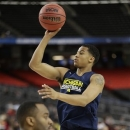 Michigan's Trey Burke shoots during practice in the NCAA Final Four tournament college basketball semifinal game against Syracuse, Friday, April 5, 2013, in Atlanta. Michigan plays Syracuse in a semifinal game on Saturday. (AP Photo/John Bazemore)
