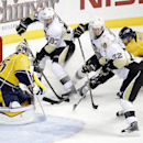 Pittsburgh Penguins center Sidney Crosby (87) scores a goal against Nashville Predators goalie Pekka Rinne (35), of Finland, in the first period of an NHL hockey game Saturday, Oct. 25, 2014, in Nashville, Tenn The Associated Press