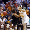 Stanford forward Chiney Ogwumike (13) drives against Tennessee center Isabelle Harrison (20) in the first half of an NCAA college basketball game on Saturday, Dec. 22, 2012, in Knoxville, Tenn. (AP Photo/Wade Payne)