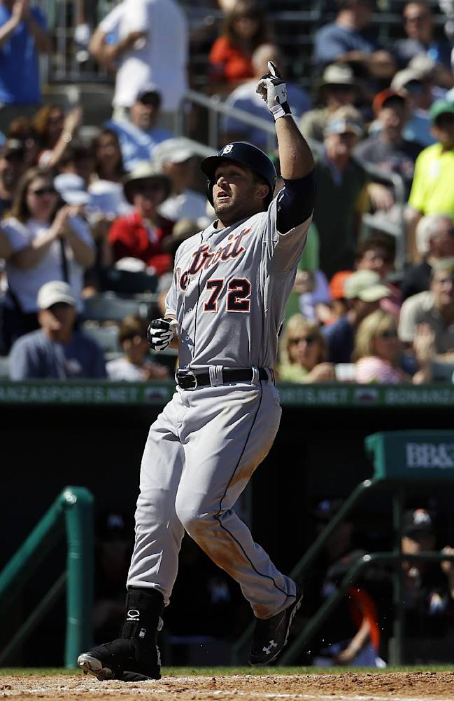 Detroit Tigers' Tyler Collins points to the sky as he crosses home plate after hitting a home run in the seventh inning of an exhibition spring training baseball game against the Miami Marlins, Sunday, March 9, 2014, in Jupiter, Fla