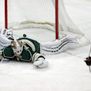 Corrects to Jan. 8 not 7 - Minnesota Wild goalie Niklas Backstrom, left, of Finland, gives up a power-play goal to Chicago Blackhawks' Patrick Kane, right, in the first period of an NHL hockey game, Thursday, Jan. 8, 2015, in St. Paul, Minn The Associated