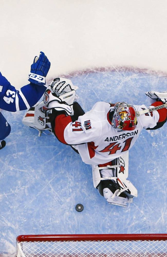Toronto Maple Leafs' Nazem Kadri, left, celebrates a goal by teammate Joffrey Lupul against Ottawa Senators goalie Craig Anderson, right, during second-period action of an NHL hockey game in Toronto, Saturday, Oct. 5, 2013. (AP photo/The Canadian Press, Mark Blinch)
