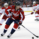Washington Capitals center Nicklas Backstrom (19), from Sweden, controls the puck in front of Carolina Hurricanes defenseman Ron Hainsey (65) in the second period of a preseason NHL hockey game, Sunday, Oct. 5, 2014, in Washington The Associated Press
