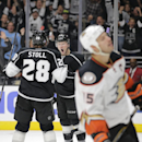 Los Angeles Kings' Tyler Toffoli, center, celebrates his goal with Jarret Stoll as Anaheim Ducks' Ryan Getzlaf, foreground, skates during the second period of an NHL hockey game Saturday, Nov. 15, 2014, in Los Angeles The Associated Press