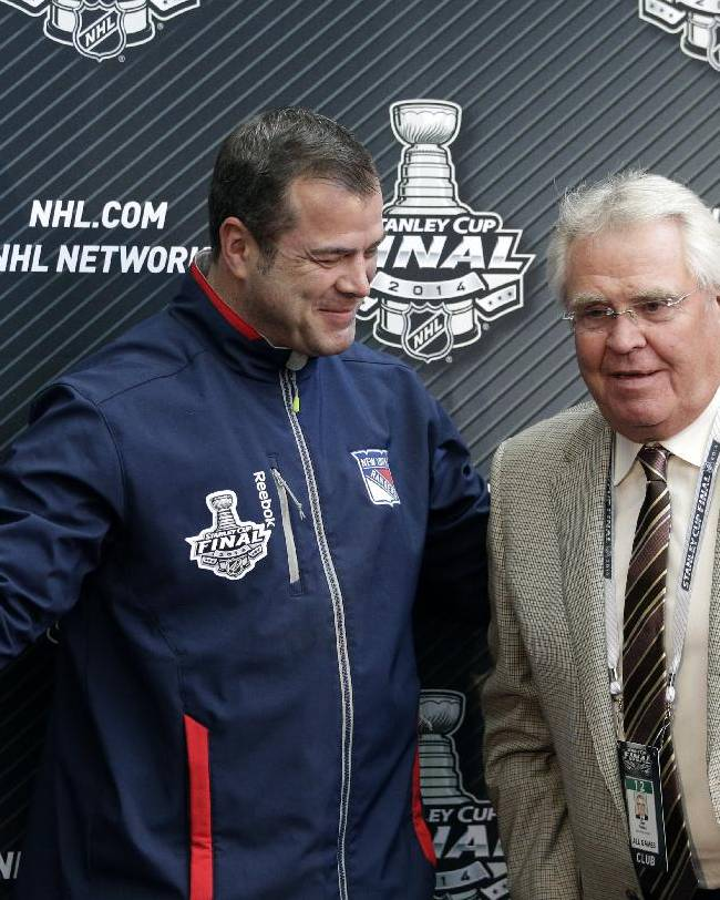 New York Rangers head coach Alain Vigneault, left, shows the way to the team's president and general manager Glen Sather after a news conference on Tuesday, June 3, 2014, in Los Angeles. The New York Rangers plays the Los Angeles Kings for in Game 1 of NHL Stanley Cup Final hockey series Wednesday