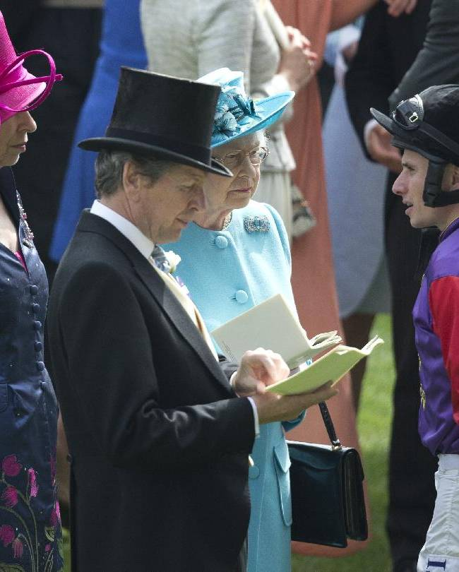 Britain's Queen Elizabeth II talks to her jockey Ryan Moore, in the parade ring ahead of the Gold Cup race in which her horse Estimate finished second behind Leading Light, on the third day of the Royal Ascot horse racing meeting, which is traditionally known as Ladies Day, at Ascot, England, Thursday June 19, 2014.  Royal Ascot the annual five day horse race meeting that Britain's Queen Elizabeth II attends every day of the event