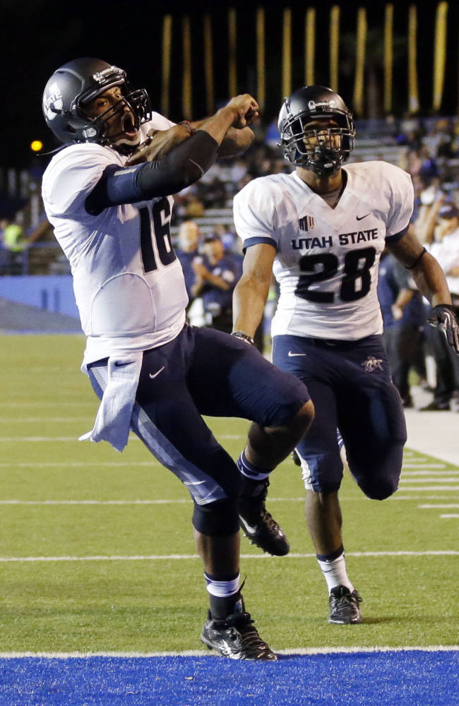 Utah State quarterback Chuckie Keeton (16) scores against San Jose State during the second half of an NCAA college football game on Friday, Sept. 27, 2013, in San Jose, Calif